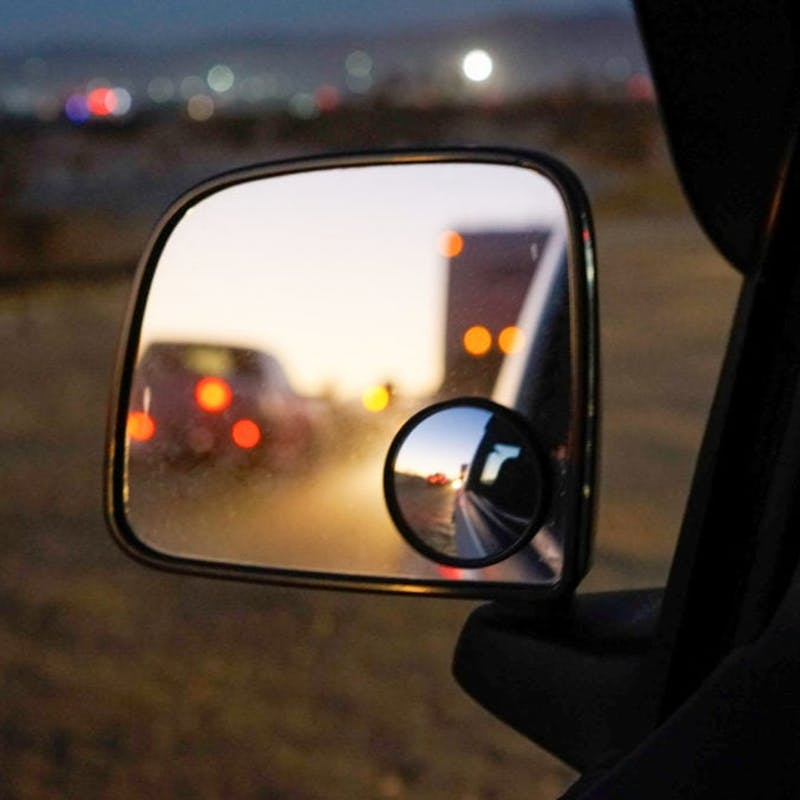The reflection of RVs through a car's side mirror.