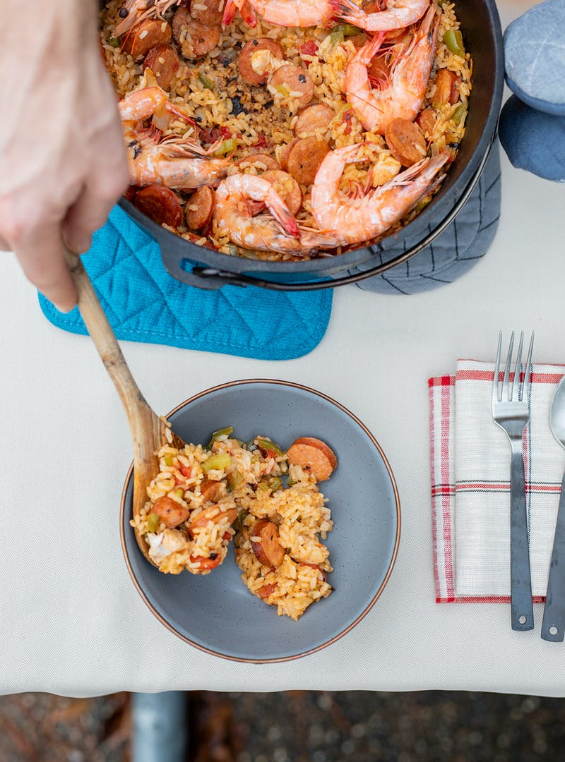 Serving up a bowl of jambalaya straight from the pot.