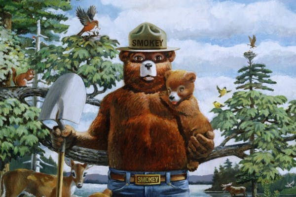 Smokey Bear painting, holding bear cub and shovel 75th anniversary