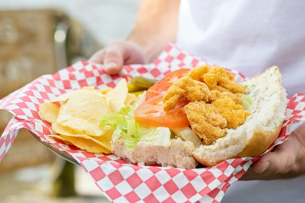 Crispy fried shrimp on a french roll with remoulade, tomatoes and lettuce.