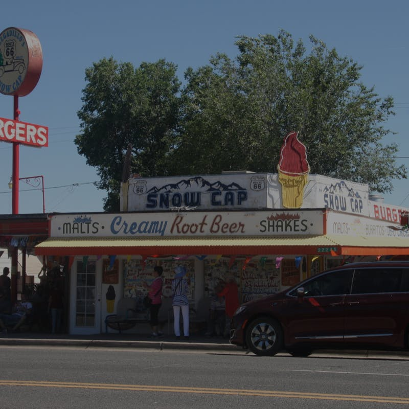 Delgadillos Snow Cap Drive-In restaurant with red van in front