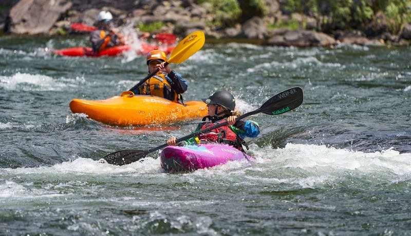 Two participants practice their new kayaking skills in the Blackfoot River.