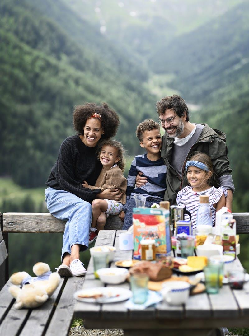 A family has a picnic on their RV vacation through the Austrian mountains.