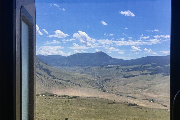 A view out an RV window to Yellowstone National Park.
