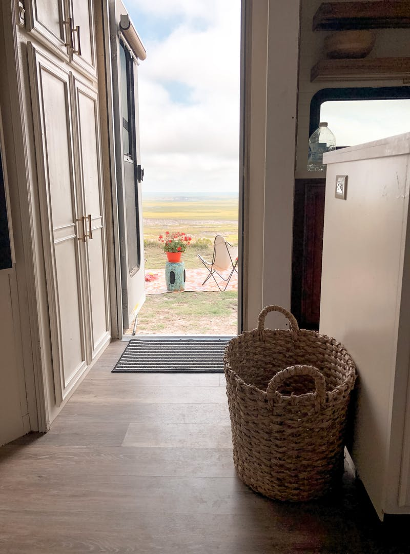 A view looking outside of Shannon Carew's door to her Highland Ridge RV.