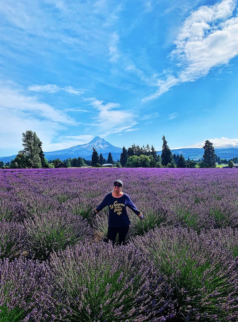 A woman posed in a field of lavender.