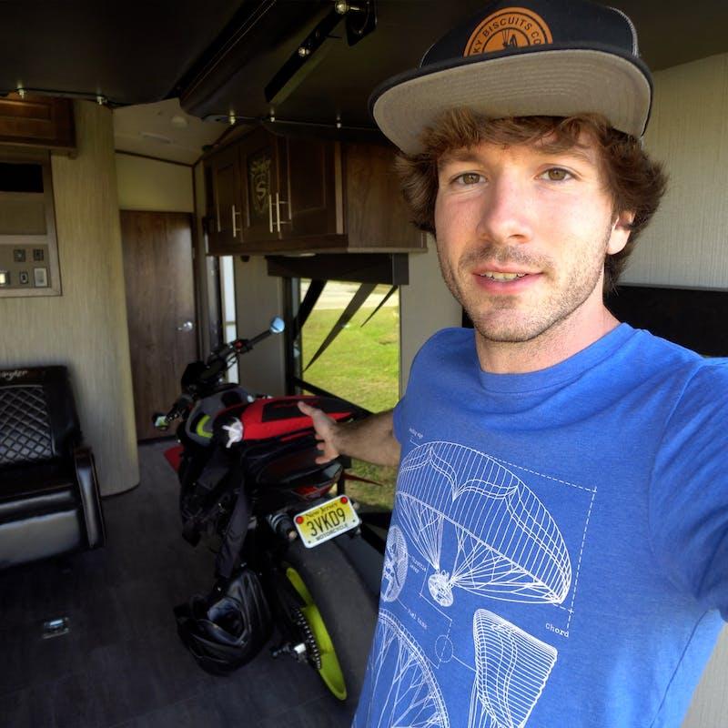 Tucker Gott takes a selfie inside the garage of his Cruiser Stryker RV.
