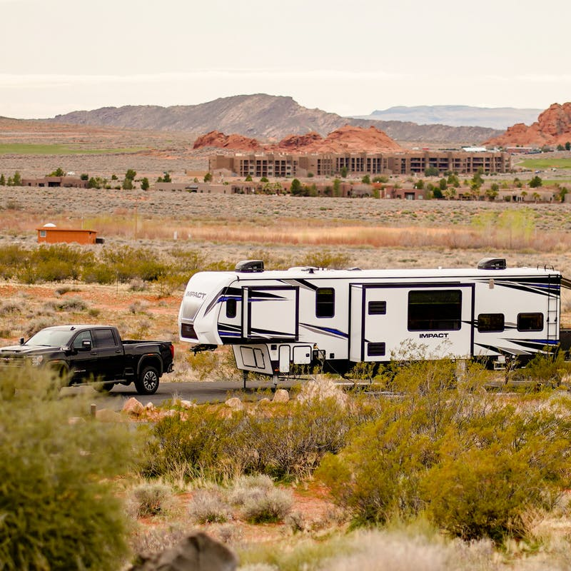 An RV driving through Sand Hallow State Park in Utah.