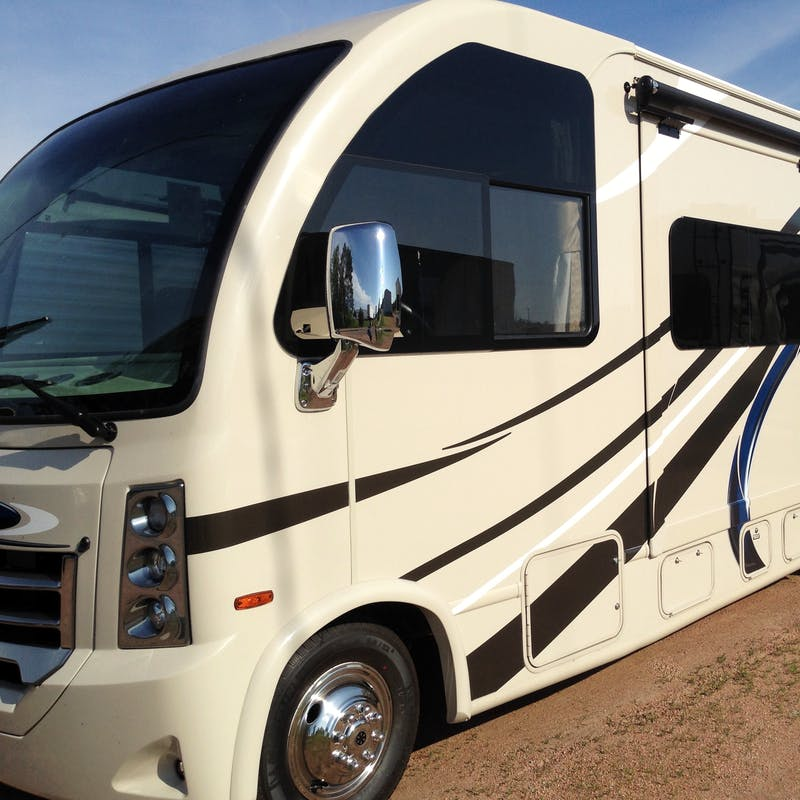 A side shot of a brand new RV.