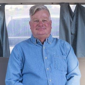 A headshot of Bill Hartig inside the family Airstream.