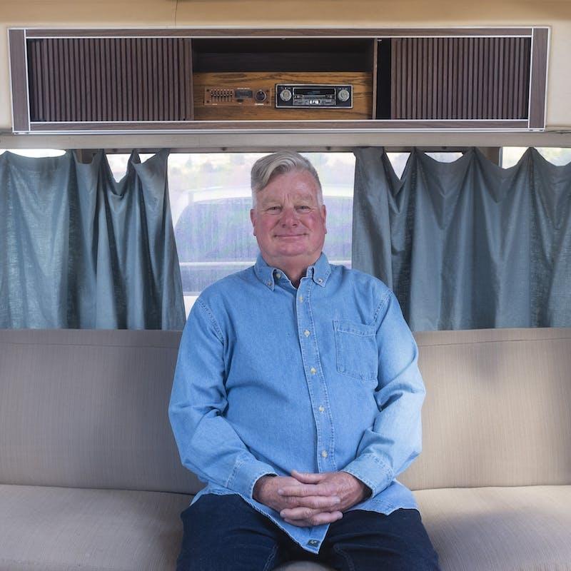 Bill Hartig sitting inside the family RV.