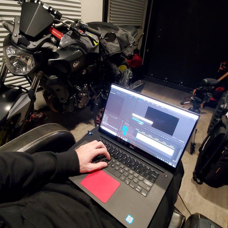 Tucker Gott edits a film on his computer in the garage of his Cruiser Stryker RV.