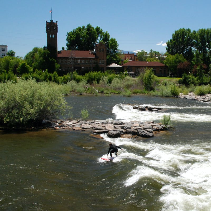 Eric Hannan surfing in a river.