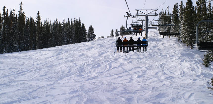 A chair lift carrying people up Copper Mountain.
