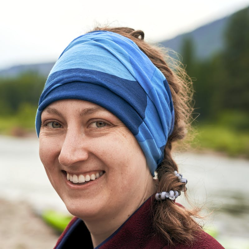 A portrait of a participant smiling in front of the Blackfoot River.