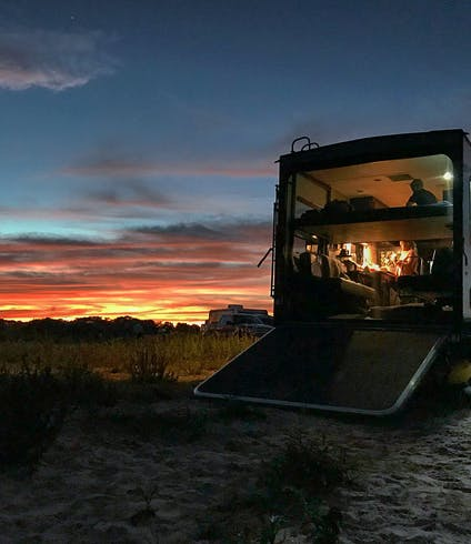 A toy hauler RV at sunset