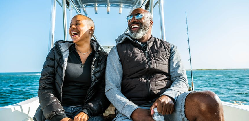 Sonya Lowery and Ray Young laugh while on a deep sea boating trip.