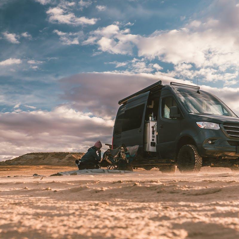 A Class B van parked in the desert