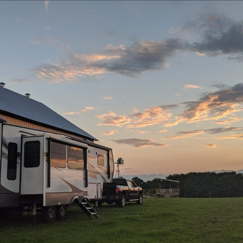 Mike and Brittany Ciepluch's Keystone Montana fifth parked at dusk.