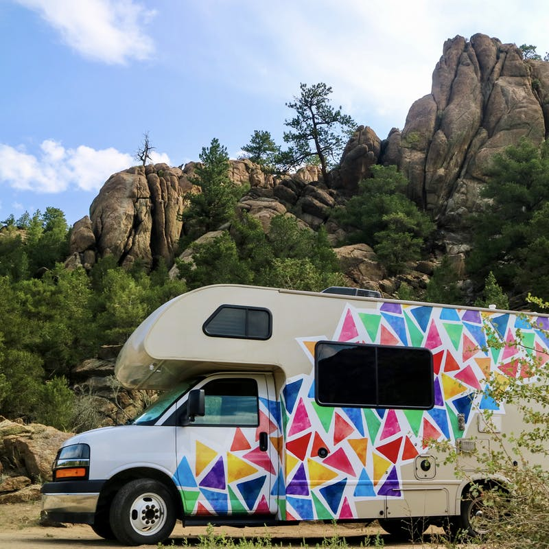 Jason and Dawn's Class C RV parked near large rocks as they boondock.