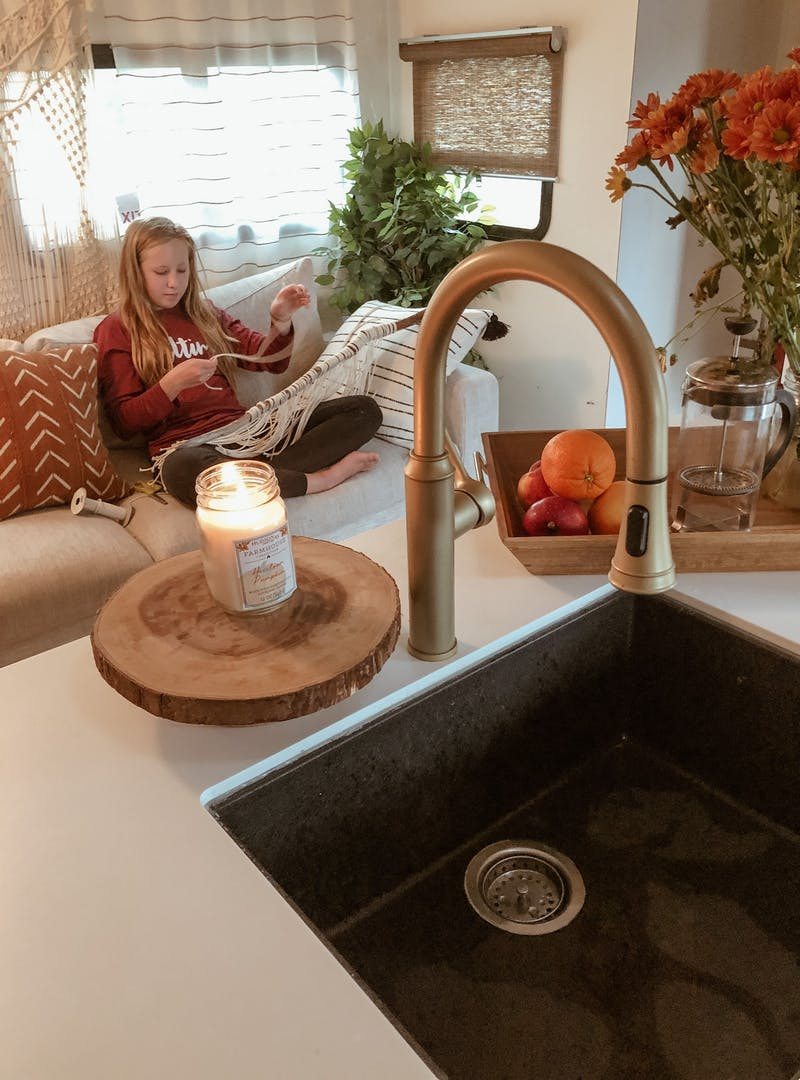 Shannon Carew's oldest child does a craft while sitting inside their Highland Ridge RV.