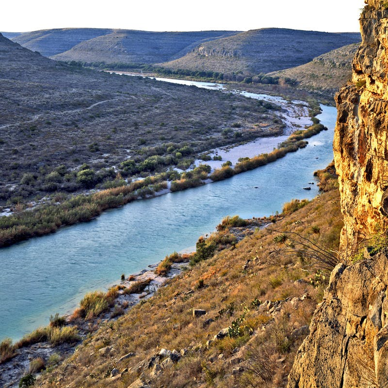 A shot of Devils River winding across the landscape in golden light.