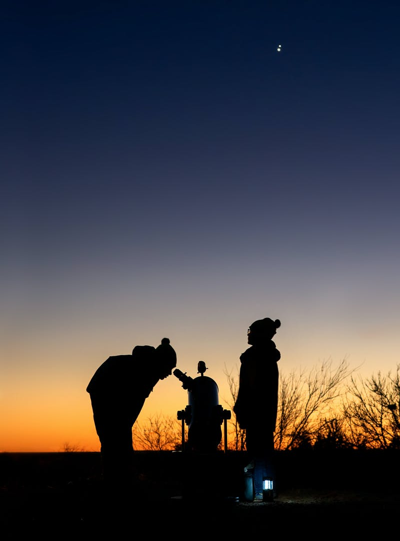 Alison Takacs's children look through a telescope.