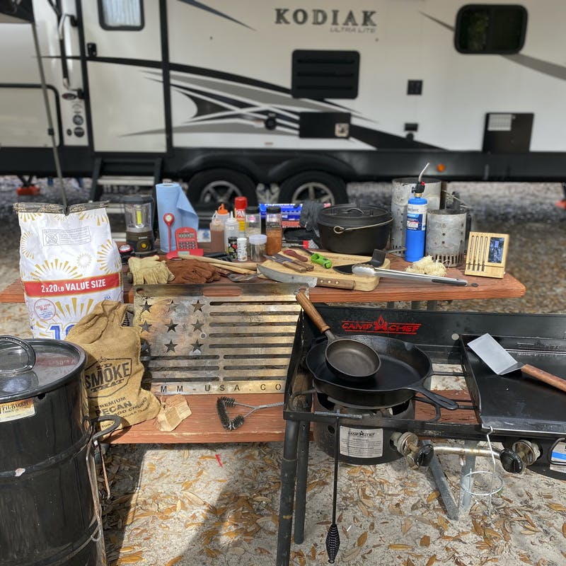 Abby Booth's grilling tools and table set up in front of her Dutchmen Kodiak travel trailer.