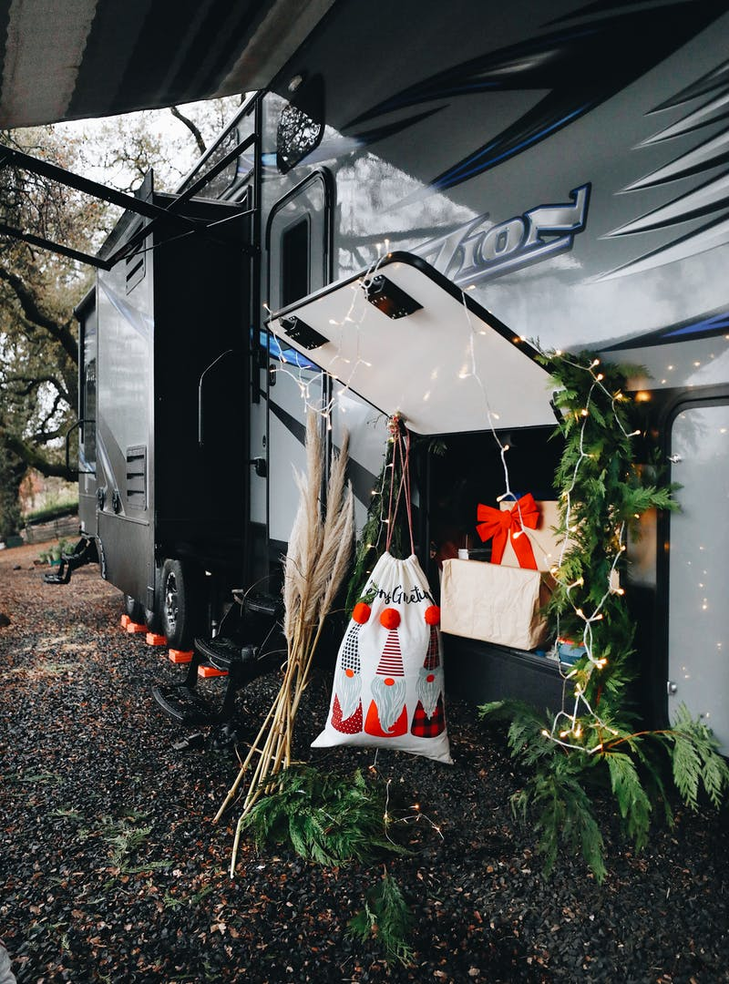 Gifts and decorations piled around the outside storage door on an RV.