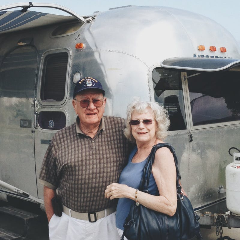 Bill's father and his stepmother, Joyce, standing with the Airstream.