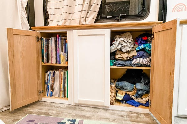 Clothes and school work organized in storage cupboards inside Brittnee Proha's Heartland Cyclone.