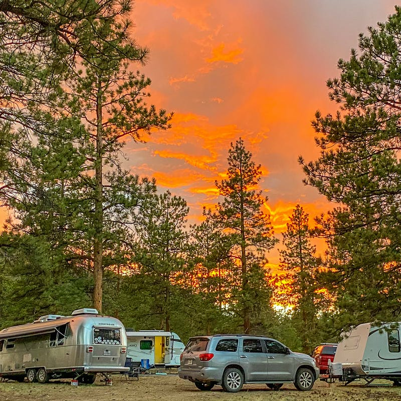 Greg Graham's Airstream and multiple RVs parked in a circle under an orange sky.