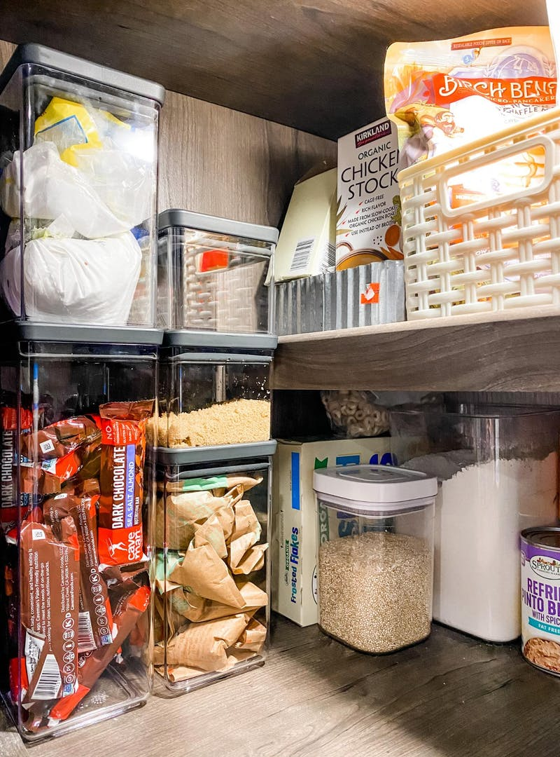 Clear canisters in Brittnee Proha's pantry helping to keep snacks and dry goods organized inside her Heartland Cyclone.