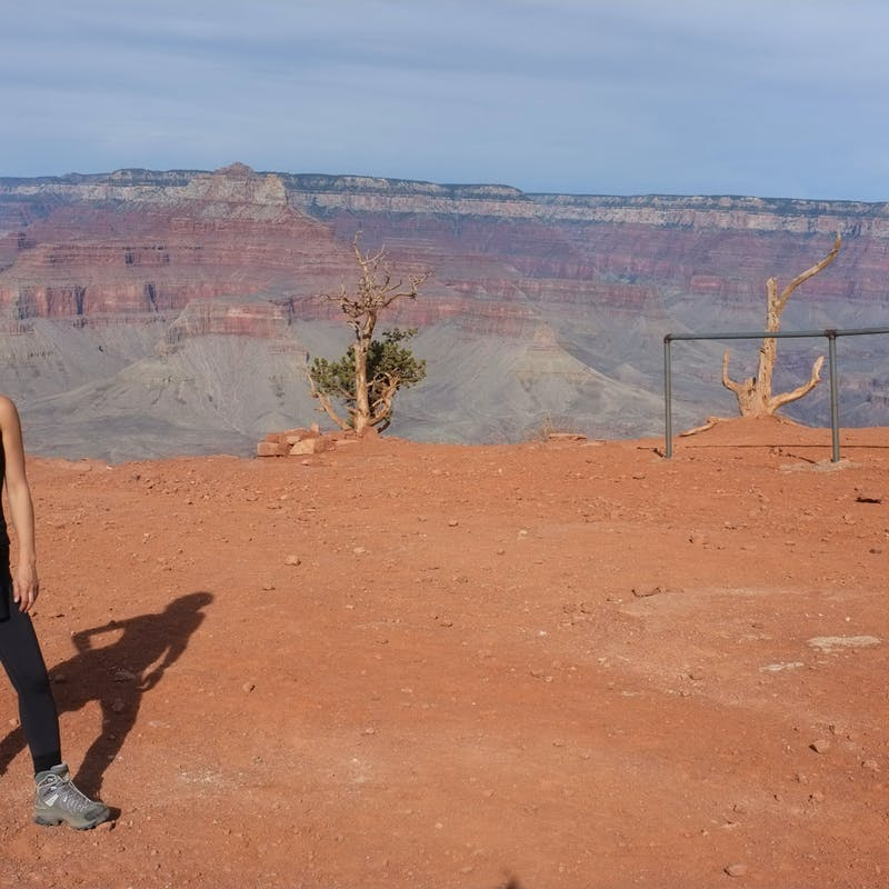 Dr. Na posing for a picture at the Grand Canyon.