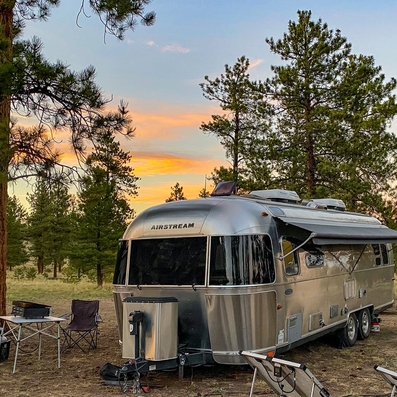 Greg Graham's Airstream parked at a campsite as sun sets.