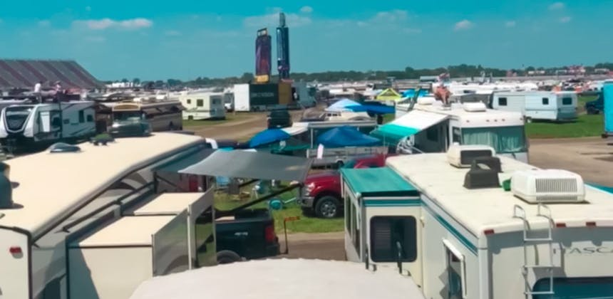 A rooftop view of multiple RVs parked at a NASCAR Race