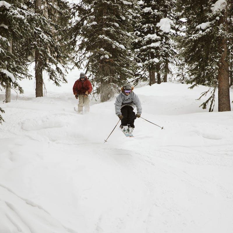 Ryan catching air on a ski slope.