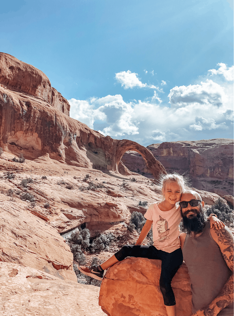 Justin Russell and his daughter pose for a picture on a hike.