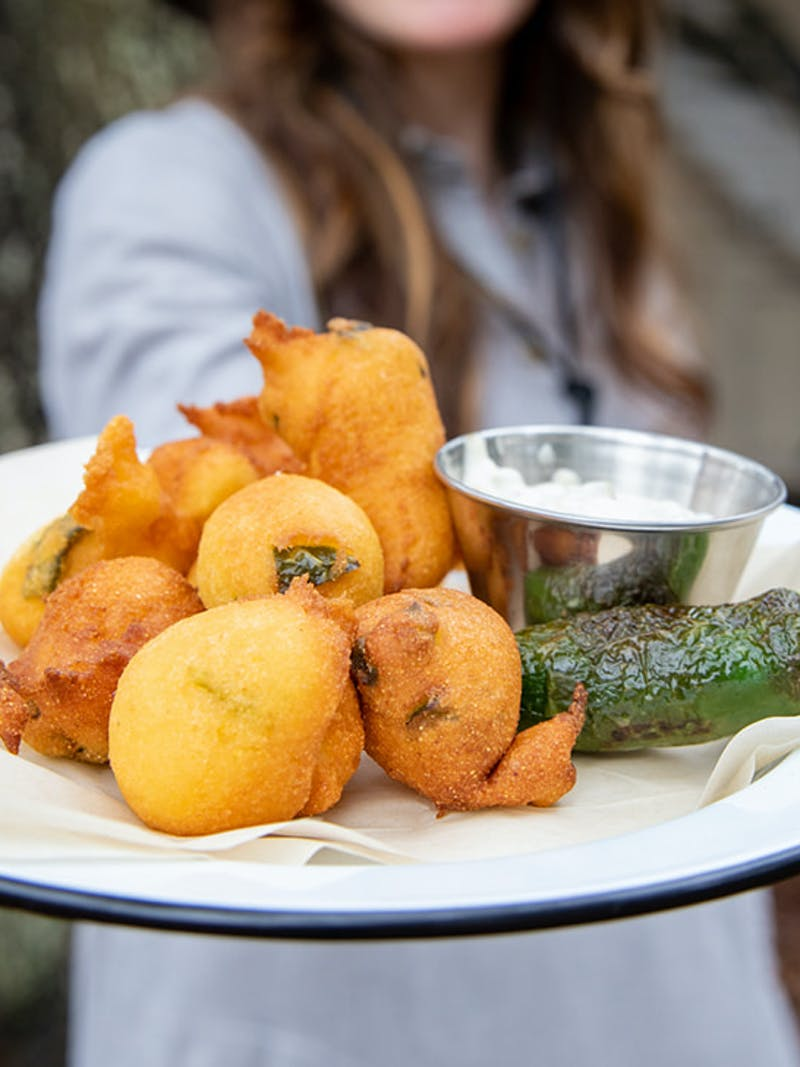 A plate of freshly fried jalapeño hush puppies.