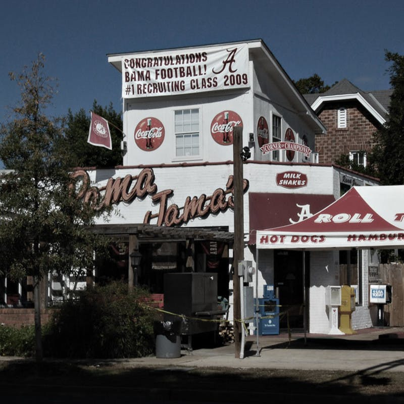 Rama Jama's classic diner restaurant near University of Alabama in Tuscaloosa, Alabama with Roll Tide football and Coca-Cola signs.