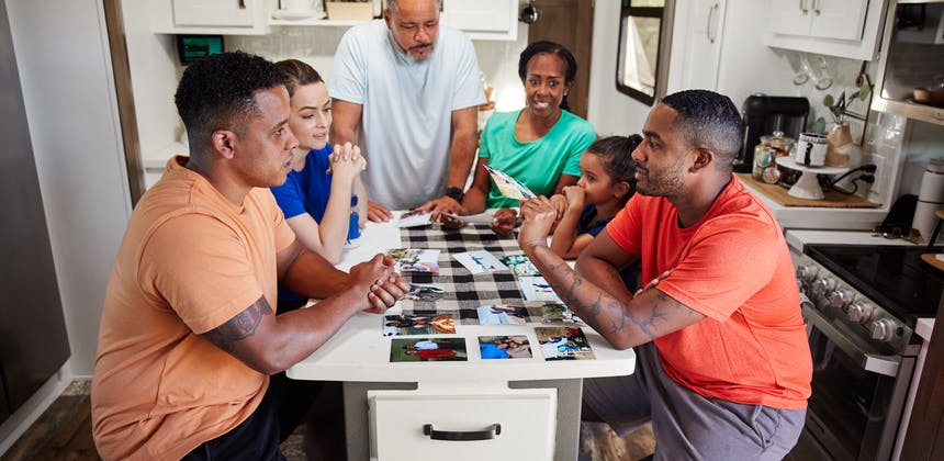 Robin and Warren's family sit around the island in the kitchen of their Keystone Fuzion.