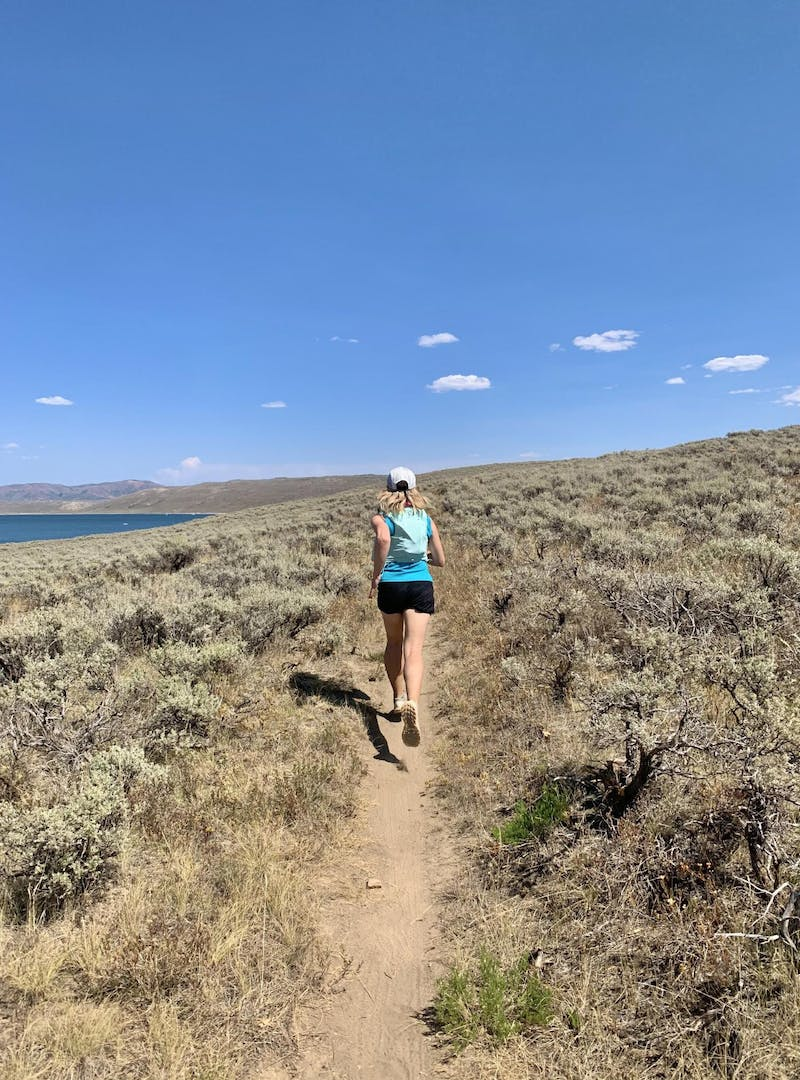 A woman trail running near Spanish Fork, Utah.