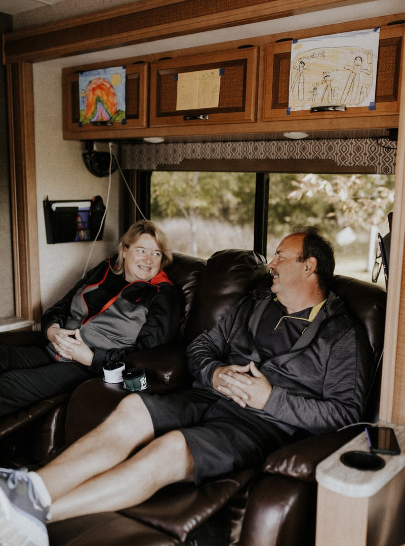 The Bolands putting their feet up in the recliner chairs inside their Thor Vegas RV.