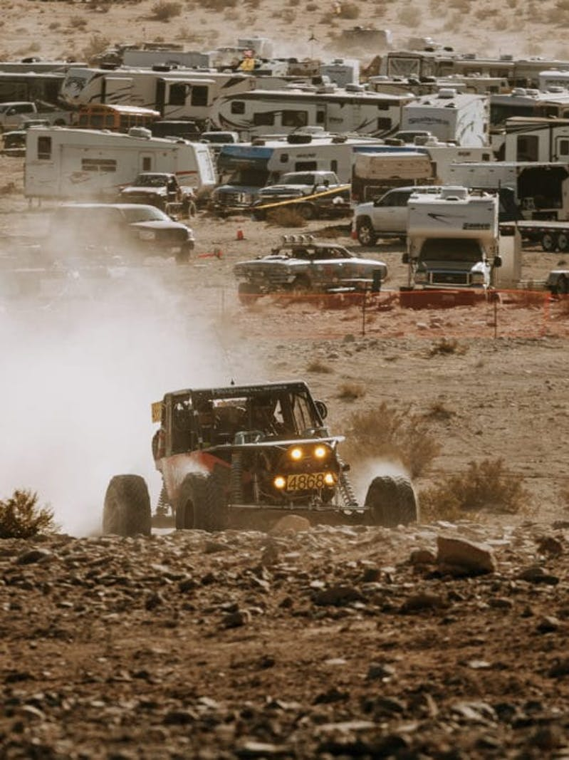 Ultra4 vehicle crawling through a rock section during the King of the Hammers race.