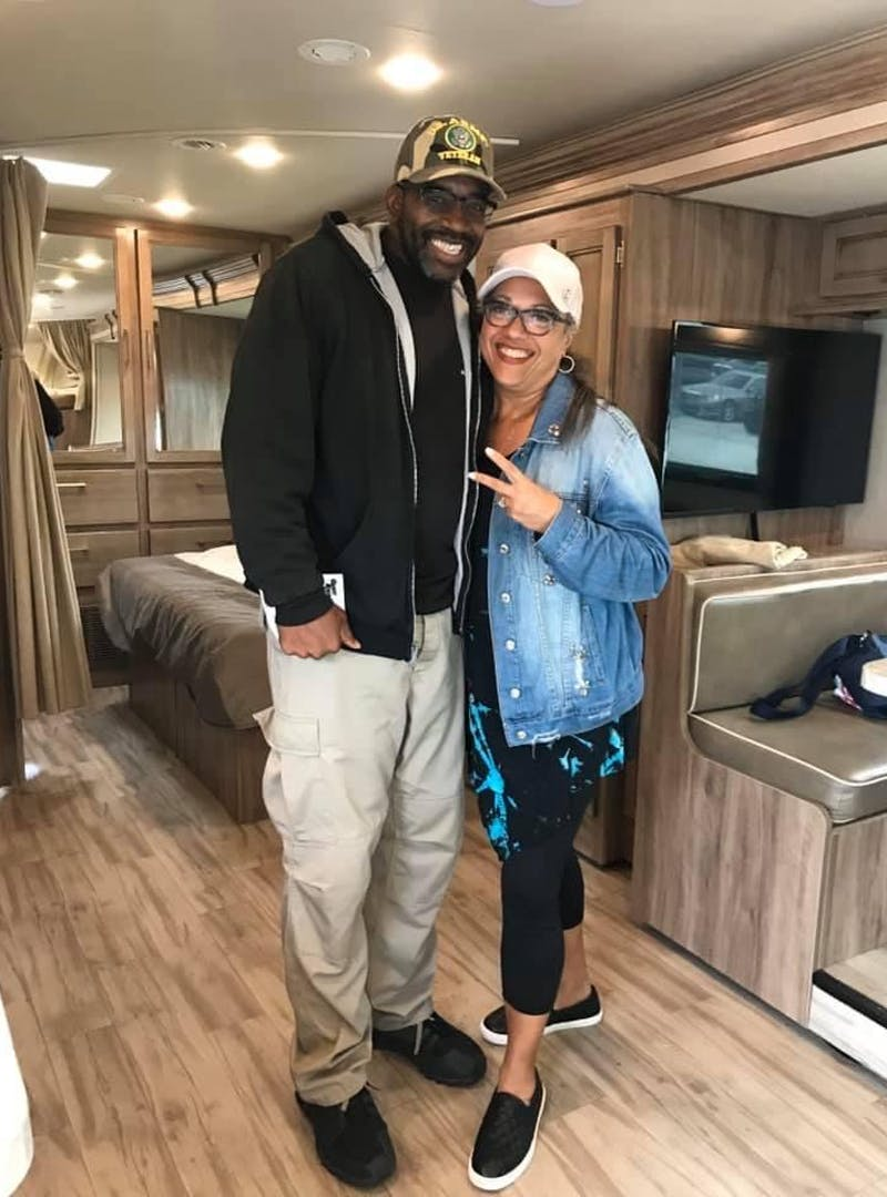 Kirsten and Mack Womack posing inside their Entegra Odyssey Class C RV on the day they purchased it.