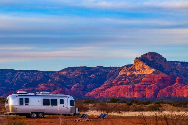 Greg Graham's Airstream parked by mountains at sunset.