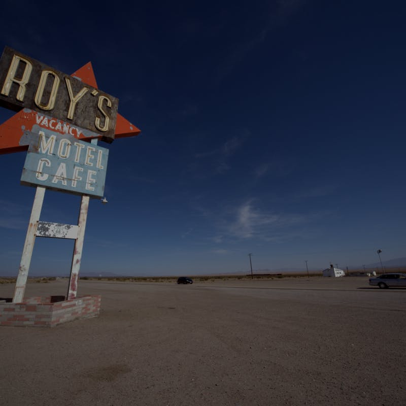 Blue sky with Roy's Motel Cafe sign in Amboy, California