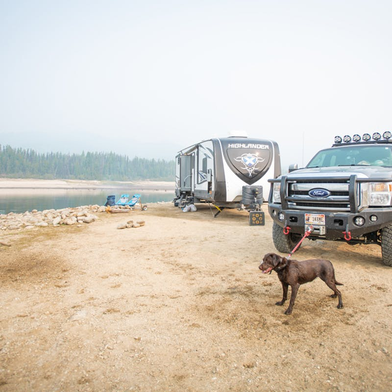 Nate Day's dog on a leash next to an RV and truck.