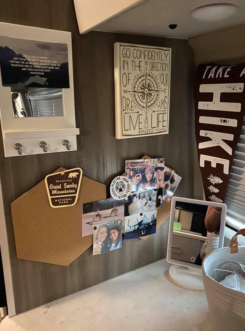 A wall in Jess Lawson's Thor Motor Coach Tellaro with photos and memorabilia from places she has visited.