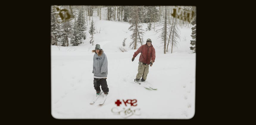 Ryan Barrick and a friend skiing outside an RV window.
